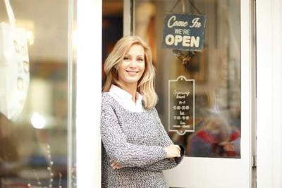 Woman in Doorway of Shop