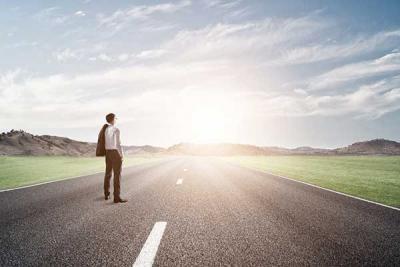 Man Looking Down Road